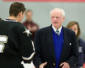 Longtime Army coach and father of Army's current coach Jack Riley speaks to Cody Omilusik (Army - 6) prior to dropping the puck. - The host Colgate University Raiders defeated the Army Black Knights 3-1 in the first Cape Cod Classic on Saturday, October 9, 2010, at the Hyannis Youth and Community Center in Hyannis, MA.