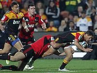 Chiefs' Jackson Willison is tackled by Crusaders' Adam Whitelock in a Super Rugby match, Waikato Stadium, Hamilton, New Zealand, Friday, July 06, 2012.  Credit:SNPA / David Rowland