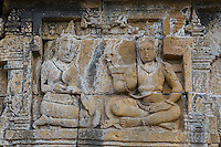 Borobudur, Java, Indonesia.  Bas-relief Stone Carving Showing Scenes from the Life of the Buddha.