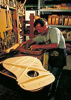 Wood craftsman building guitar. Wood Craftsman