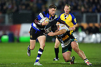 Rhys Priestland of Bath Rugby looks to get past Kieran Brookes of Northampton Saints. Aviva Premiership match, between Bath Rugby and Northampton Saints on February 10, 2017 at the Recreation Ground in Bath, England. Photo by: Patrick Khachfe / Onside Images