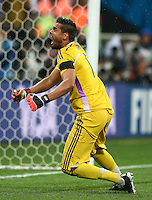 Argentina goalkeeper Sergio Romero celebrates saving the penalty of Wesley Sneijder of Netherlands during the penalty shootout