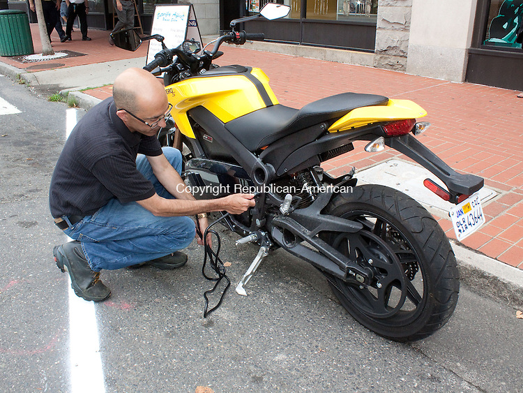 WATERBURY CT.-30 AUGUST 2013 083113DA06- City-based paralegal who is also an editor of a motorcycle magazine Sean Goulart had a two-week test drive with a rare fully-electric Zero S motorycle and demonstrates were the power cord would be connected.<br /> Darlene Douty Republican American