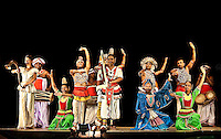 Taking a bow after a great performance of song and dance in front of an appreciative audience. (Photo by Matt Considine - Images of Asia Collection)