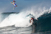 RICARDO SANTOS (BRA)  flies through the air while DYLAN LONGBOTTOM (AUS)  rides a wave during their heat at Teahupoo, Tahiti, Tuesday May  2009. The opening rounds of the Air Tahiti Nui Von Zipper Trials were held today in 2 meter waves today at Teahupoo. The trials are made up of 64 surfers, 32 locals plus 32 internationals with a waiting period  from the 2-6 May. The winner will be awarded a wildcard into the 2009 WCT Billabong Pro Tahiti main event.  A mini WCT in its own right, the Air Tahiti Nui VZ trials are comprised of the most respected and revered big wave surfers from around the world. Standouts today included BRUCE IRONS (HAW), ALAIN RIOU (PYF) and MARK VISSER (AUS). Photo: joliphotos.com