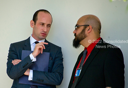 White House Policy Advisor Stephen Miller, left, has a conversation with an unidentified guest on the Colonnade as Associate Justice of the United States Supreme Court Neil Gorsuch takes the Oath of Office from Associate Justice Anthony Kennedy in theRose Garden of the White House in Washington, DC on Monday, April 10, 2017.<br /> Credit: Ron Sachs / CNP<br /> (RESTRICTION: NO New York or New Jersey Newspapers or newspapers within a 75 mile radius of New York City)