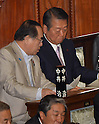 June 26, 2012, Tokyo, Japan - Ichiro Ozawa, right, a stalwart member of the ruling Democratic Party of Japan, checks the result of votes with Hiroshi Nakai during a plenary session of the Diet lower house in Tokyo on Tuesday, June 26, 2012..The House of Representatives passed the sales tax hike legislation with the backing of two main opposition parties by 363 to 96 votes. Ozawa and his followers voted against the legislation, causing a severe division within the ruling party. (Photo by Natsuki Sakai/AFLO).