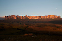 Sunset at Mount Roraima or Roraima Plateau ( also known as Roraima Tepui or Cerro Roraima in Spanish, and Monte Roraima in Portuguese ) in Canaima National Park, this is the highest of the Pakaraima chain of tepui plateau in South America. Mount Roraima lies on the Guiana Shield in the southeastern corner of Venezuela's Canaima National Park. The tabletop mountains of the park are considered some of the oldest geological formations on Earth, dating back to some two billion years ago in the Precambrian Era. The mountain includes the triple border point of Venezuela, Brazil and Guyana.