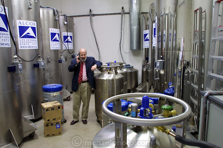 Alcor Life Extension (Cryonic) Company, Scottsdale, AZ. Cryonics is a speculative life support technology that seeks to preserve human life in a state that will be viable and treatable by future medicine. Jerry B. Lemler, MD, president and CEO of Alcor, in the cryonic storage tank room. The tanks contain frozen bodies and heads. Ted William's dismembered frozen head is one of these tanks. Lemler resigned in 2003 after he was diagnosed with cancer..