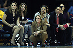 11 November 2012: Duquesne head coach Suzie McConnell-Serio kneels in front of her staff including (from left) Rachel Wojdowski, Lindsay Richards, Carmen Bruce, and Dan Burt. The University of North Carolina Tar Heels played the Duquesne University Dukes at Carmichael Arena in Chapel Hill, North Carolina in an NCAA Division I Women's Basketball game, and a quarterfinal in the Preseason WNIT. UNC won the game 62-58