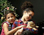 "Prospect, CT- 22 December 2016-122216CM03-Zamiyiah Gordon, left, 8 and her sister Naccea Gordon 10 of Waterbury hold a baby goat (called a kid) during a Christmas Party for Kelly's Kids at the Cronin Farm in Prospect on Thursday.  The kid was two days old and was part of an ""old fashioned farm Christmas party"" was held by Kelly Cronin, executive director at Kelly's Kids.  The program allows ""children to be children"" said Cronin.  It also helps them to learn and grow through education and recreation programs.   Christopher Massa Republican-American"