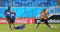Mario Balotelli of Italy scores a goal past goalkeeper Gianluigi Buffon during training ahead of tomorrow's Group D match vs Uruguay