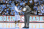 16 December 2015: North Carolina's Marcus Paige (left) is presented with a commemorative game ball honoring his setting a new record for three pointers made by a UNC player. The ball is being presented by the former record holder and current Tulane assistant coach Shammond Williams. The University of North Carolina Tar Heels hosted the Tulane University Green Wave at the Dean E. Smith Center in Chapel Hill, North Carolina in a 2015-16 NCAA Division I Men's Basketball game. UNC won the game 96-72.