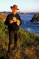 California, Mendocino, Man with wild mushrooms