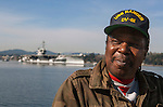 Frank Jenkins served as a jet engine mechanic from 1976 to 1980 onboard the USS Ranger as it is towed from Puget Sound Naval Shipyard's Inactive Ship Maintenance Facility in Bremerton, WA. on March 5, 2015. The carrier is en route to be scraped at International Shipbreaking in Texas.The aircraft carrier was active from 1957 to 1993, when it entered the mothball fleet. The Navy announced a deal Dec. 22 to pay a penny and the value of the ship's scrap metal to take it away. It must make a five-month, 16,000-mile trip around South America because it can't fit through the Panama Canal.  ©2015. Jim Bryant Photo. All RIGHTS RESERVED.