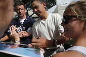 Kailua, HI - December 30, 2008 -- United States President-Elect Barack Obama greets well-wishers and signs an autographs after a morning game of basketball with friends at Punahou School on  after Tuesday  December 30, 2008 in Honolulu, Hawaii. Obama and his family arrived in his native Hawaii December 20 with his family for the Christmas holiday..Credit: Kent Nishimura - Pool via CNP