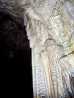 STALACTITES &amp; STALAGMITES IN LIMESTONE CAVERN<br /> Big Room, Draperies<br /> Calcium carbonate deposits (Stalactites) hang from the top of limestone caverns, formed by the dripping of mineralized solutions. Corresponding columnar deposits (Stalagmites) are built upward. Carlsbad.