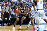 05 February 2017: Notre Dame's V.J. Beachem (3) is guarded by North Carolina's Joel Berry II (2) and Tony Bradley (5). The University of North Carolina Tar Heels hosted the University of Notre Dame Fighting Irish at the Greensboro Coliseum in Greensboro, North Carolina in a 2016-17 Division I Men's Basketball game. The game had been postponed one day and moved from Chapel Hill due to a water shortage. UNC won the game 83-76.