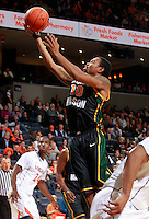CHARLOTTESVILLE, VA- DECEMBER 6: Sherrod Wright #10 of the George Mason Patriots shoots over K.T. Harrell #24 of the Virginia Cavaliers during the game on December 6, 2011 at the John Paul Jones Arena in Charlottesville, Virginia. Virginia defeated George Mason 68-48. (Photo by Andrew Shurtleff/Getty Images) *** Local Caption *** K.T. Harrell;Sherrod Wright
