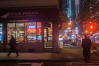 Church Street in Lower Manhattan in New York showing Star Pizza and other stores is seen on Thursday, February 28, 2013.  (© Richard B. Levine)