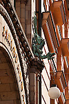 A dragon holding a lamp on a building in Stockholm, Sweden