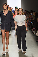 Graduating design student Allison Martell, walks runway with model at the close of 2017 Pratt fashion show on May 4, 2017 at Spring Studios in New York City.