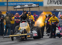 Oct 2, 2016; Mohnton, PA, USA; The dragster of NHRA top fuel driver Doug Kalitta comes off the ground with three wheels as he launches off the starting line during the Dodge Nationals at Maple Grove Raceway. Mandatory Credit: Mark J. Rebilas-USA TODAY Sports