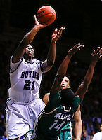 INDIANAPOLIS, IN - FEBRUARY 13: Roosevelt Jones #21 of the Butler Bulldogs shoots the ball over Terrence Williams #14 of the Charlotte 49ers at Hinkle Fieldhouse on February 13, 2013 in Indianapolis, Indiana. Charlotte defeated Butler 71-67. (Photo by Michael Hickey/Getty Images) *** Local Caption *** Roosevelt Jones; Terrence Williams