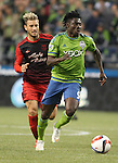 Seattle Sounders Obafemi Martins (9) controls the ball away from Portland TimbersGaston Fernandez (10) during an MLS match on April 26, 2015 at CenturyLink Field in Seattle, Washington.  Seattle Sounders Clint Dempsey scored a goal to give the Sounders a 1-0 victory over the Timbers. Jim Bryant Photo. ©2015. All Rights Reserved.