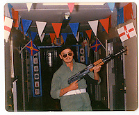 A photographs from Tommy's collection of pictures taken inside the Maze prison. A UDA member holds a replica rifle made from wood during a July 12th Loyalist celebration. 'The Twelfth' (also known as Orangemen's Day) which celebrates the 'Glorious Revolution' of 1688 (when Protestant king William III ascended the English throne) and the Battle of the Boyne (when William III defeated the catholic claimant James on the east coast of Ireland) is celebrated each year on the 12th of July. .