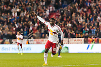 Lloyd Sam (10) of the New York Red Bulls celebrates scoring during the second half against the Chicago Fire. The New York Red Bulls defeated the Chicago Fire 5-2 during a Major League Soccer (MLS) match at Red Bull Arena in Harrison, NJ, on October 27, 2013.