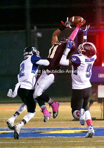 Waterbury, CT- 01 October 2015-100115CM11-  Sacred Heart's Jurrel Racine jumps up for the ball against Crosby's  Eli Mbaya (2) and Jermaine Coggins (9) during their NVL matchup in Waterbury on Thursday.   The pass was ruled incomplete.  Christopher Massa Republican-American