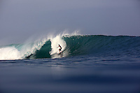 Surfing perfect waves somewhere in Sumatra.