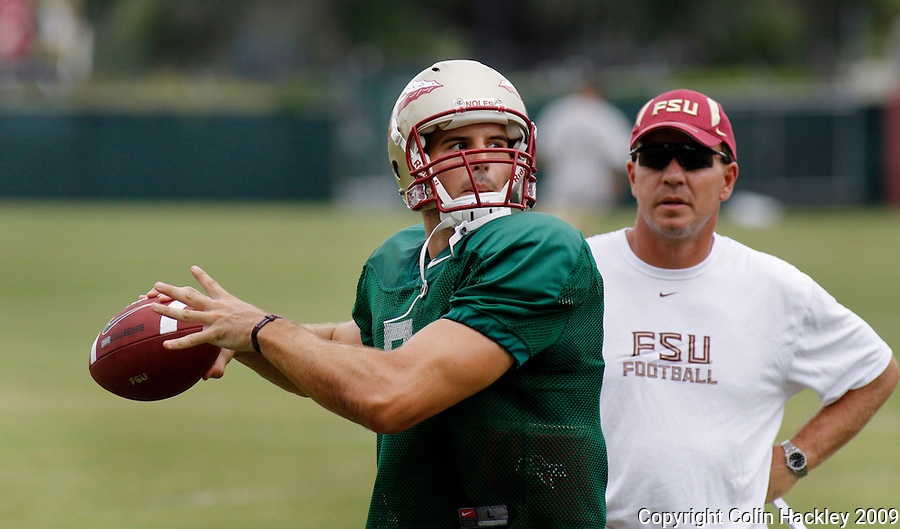 TALLAHASSEE, FL. 8/26/09-FSU-PONDER 0826 CH01-Florida State quarterback Christian Ponder, left, works with Offensive Coordinator Jimbo Fisher during practice Wednesday in Tallahassee...COLIN HACKLEY PHOTO