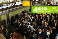 A packed platform during morning rush hour, Shinjuku, Tokyo. With up to 4 million passengers passing through it every day, Shinjuku station, Tokyo, Japan, is the busiest train station in the world. The station was used by an average of 3.64 million people per day.  That&rsquo;s 1.3 billion a year.  Or a fifth of humanity. Shinjuku has 36 platforms, and connects 12 different subway and railway lines.  Morning rush hour is pandemonium with all trains 200% full. <br /> <br /> Photo by Richard jones / sinopix