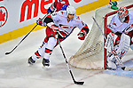 21 December 2008: Carolina Hurricanes' defenseman Tim Gleason keeps one stride ahead of Montreal Canadiens' right wing forward Alexei Kovalev from Russia in the first period at the Bell Centre in Montreal, Quebec, Canada. The Hurricanes defeated the Canadiens 3-2 in overtime. ***** Editorial Sales Only ***** Mandatory Photo Credit: Ed Wolfstein Photo