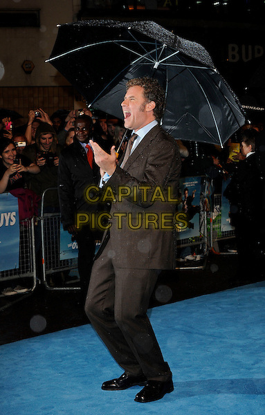 WILL FERRELL .UK Film Premiere of 'The Other Guys' at Vue West End cinema, Leicester Square, London, England, UK,.September 14th 2010..full length brown suit side umbrella funny hand raining .CAP/CAN.©Can Nguyen/Capital Pictures.
