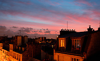 PARIS, FRANCE - NOVEMBER 21: A high angle view over the Montmartre rooftops on November 21, 2008 in Paris, France. Far below the street lights shine whilst all is quiet at chimney level beneath the pink and blue evening sky. (Photo by Manuel Cohen)