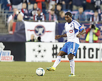 Montreal Impact midfielder Patrice Bernier (8) passes the ball.  In a Major League Soccer (MLS) match, Montreal Impact (white/blue) defeated the New England Revolution (dark blue), 4-2, at Gillette Stadium on September 8, 2013.
