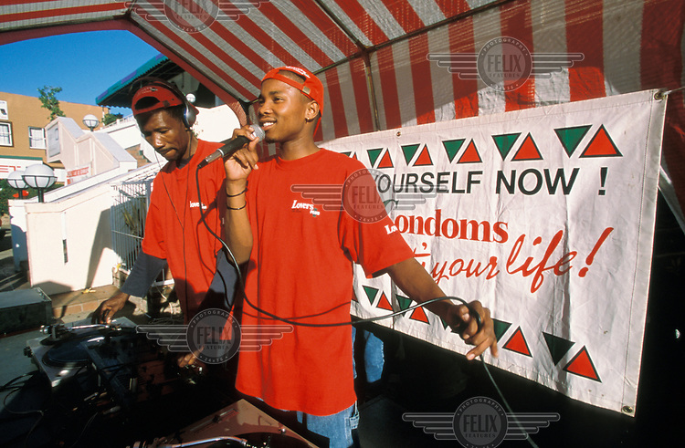 Public AIDS education performance in town centre. Peer educators use music and DJ-ing to get their health message across to young people.
