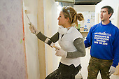 Painting & Decorating student applies paint with a roller, Able Skills, Dartford, Kent.