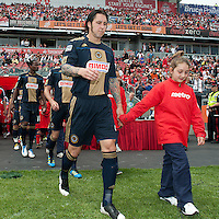 Philadelphia Union defender Danny Califf #4 walks onto the pitch during the opening ceremonies of an MLS game between the Philadelphia Union and the Toronto FC at BMO Field in Toronto on May 28, 2011..The Philadelphia Union won 6-2..