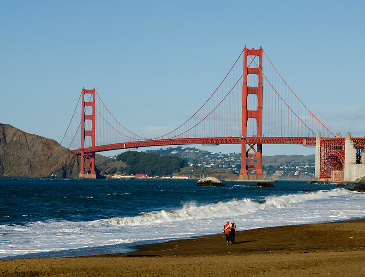 California, San Francisco: Couple and Golden Gate Bridge from Baker Beach.Photo #: 2-casanf76432.Photo © Lee Foster 2008