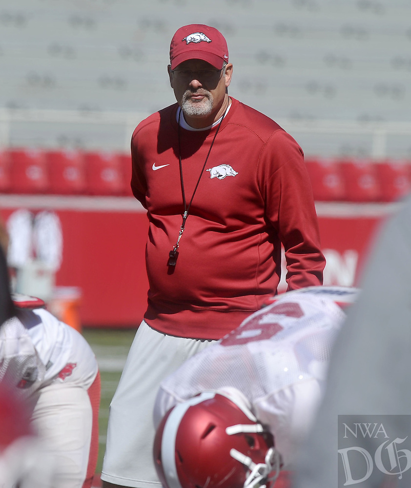 NWA Democrat-Gazette/MICHAEL WOODS &bull; @NWAMICHAELW<br /> Arkansas assistant coach Paul Rhoads watches the Razorbacks run drills during practice Saturday April 2, 2016, at Razorback Stadium.