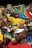 A South Africa flag amongst ANC flags at an African National Congress (ANC) election rally held at the Ellis Park Stadium in Johannesburg..