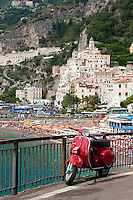 Vintage red Vespa at the seaside historic village of Amalfi, on the Unesco World Heritage Listed Amalfi Coast, Italy