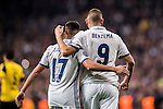 Karim Benzema of Real Madrid celebrates with teammate Lucas Vazquez during the 2016-17 UEFA Champions League match between Real Madrid and Borussia Dortmund at the Santiago Bernabeu Stadium on 07 December 2016 in Madrid, Spain. Photo by Diego Gonzalez Souto / Power Sport Images