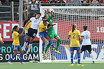 10 November 2013: Luciana (BRA) (in green) catches the ball under pressure from Abby Wambach (USA) (20). The United States Women's National Team played the Brazil Women's National Team at the Citrus Bowl in Orlando, Florida in an international friendly soccer match. The U.S. won the match 4-1.