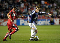 Chivas midfielder Blair Gavin (18) shields the ball from Chicago defender Deris Umanzor (13).  The Chicago Fire tied Chivas USA 1-1 at Toyota Park in Bridgeview, IL on May 1, 2010.