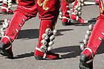 The Hispanic Parade in New York City. Detail of the red boots and bells that men are wearing while representing Argentina in the Hispanic Parade in New York City.